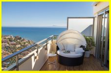 terrace of the rental apartment in Cullera with the beach of Cap Blanc and the sea in the bottom